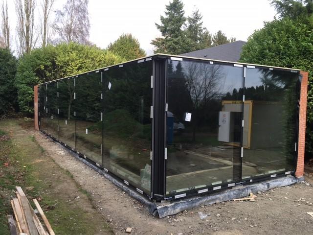 extension d une villa piscine couverte avec patio vitr mur rideau j gaspard. Black Bedroom Furniture Sets. Home Design Ideas