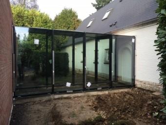 Extension d'une villa – Piscine couverte avec patio vitré – MUR RIDEAU